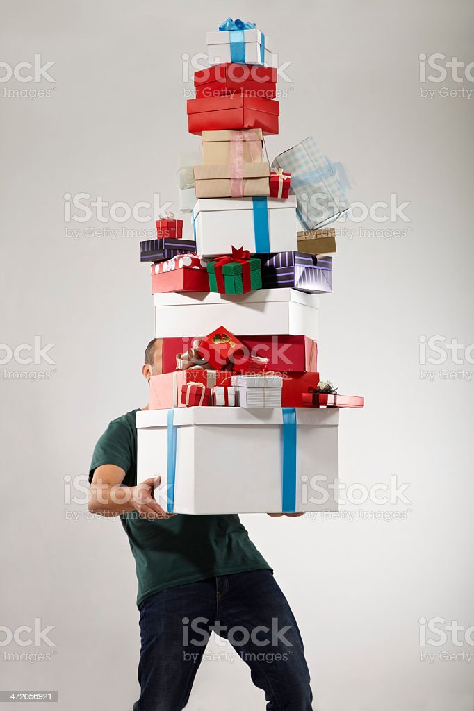 Man Carrying Stack of Gift Box stock photo