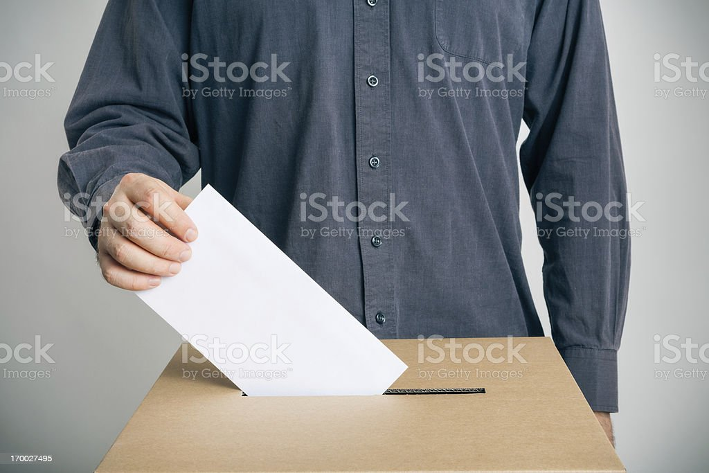 man casting his vote stock photo