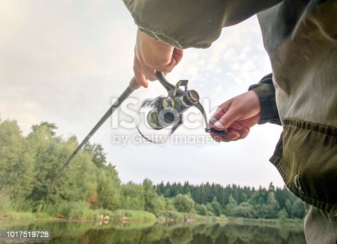 688562434 istock photo A man catches a fish with a rod in his hands. 1017519728