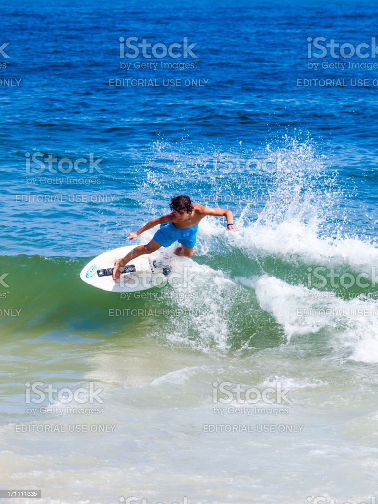 Man catches a wave at Ipanema Beach in Rio, Brazil royalty-free stock photo