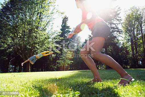 620402800istockphoto Man catching flying disk 521136686