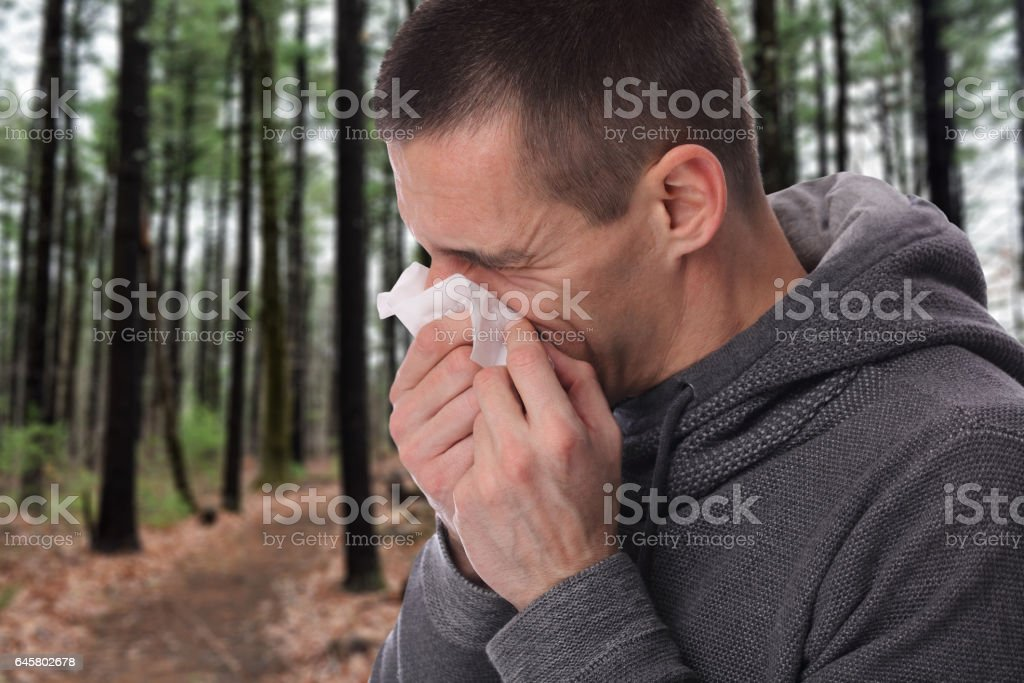Man caught cold , flu, running nose. Healthcare and medical concept stock photo