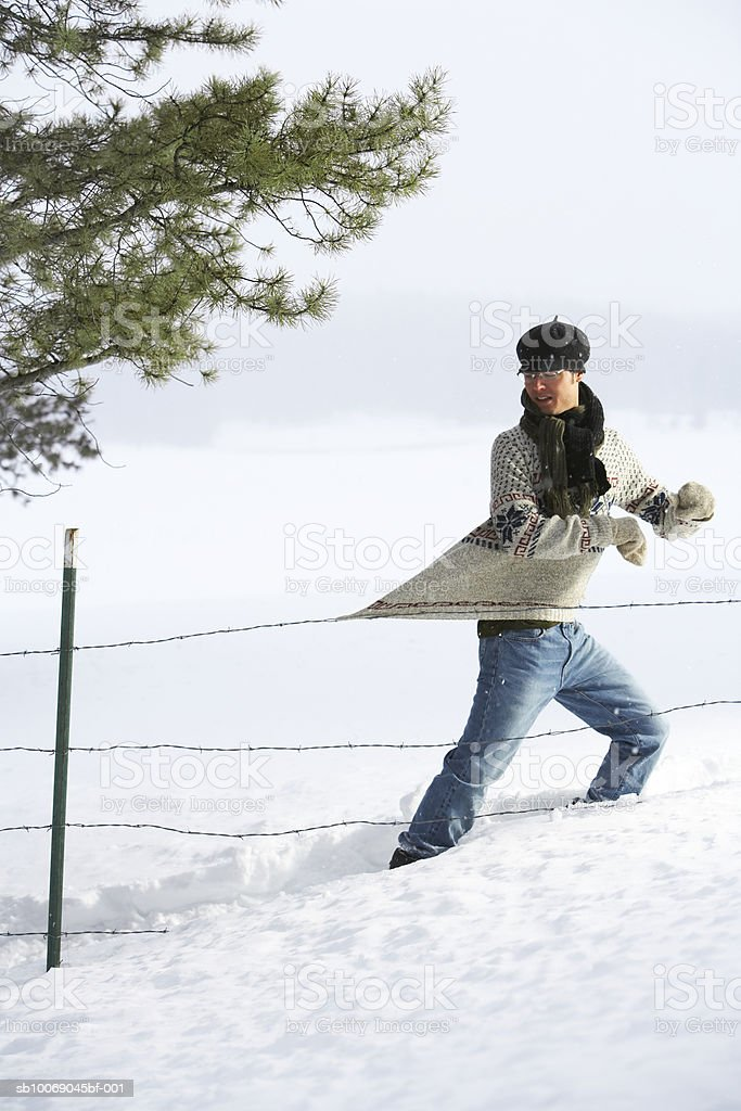 Man caught on wire fence 免版稅 stock photo