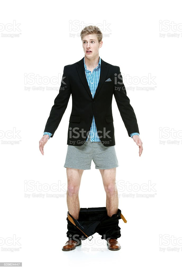 Man caught with his pants down & looking scared stock photo
