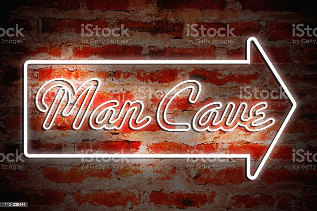 "Man Cave A neon sign that says ""Man Cave."" Arrow Symbol Stock Photo"