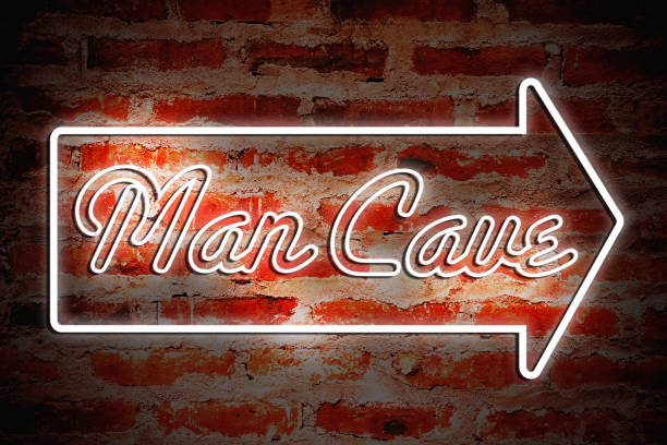 """Man Cave A neon sign that says """"Man Cave."""" man cave stock pictures, royalty-free photos & images"""