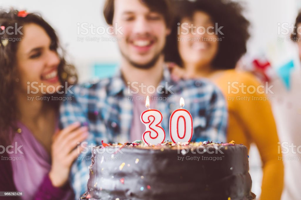 Swell Man Celebrating 30Th Birthday With Friends Stock Photo Download Personalised Birthday Cards Veneteletsinfo