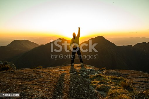 istock Man celebrating success on top of a mountain 515369338