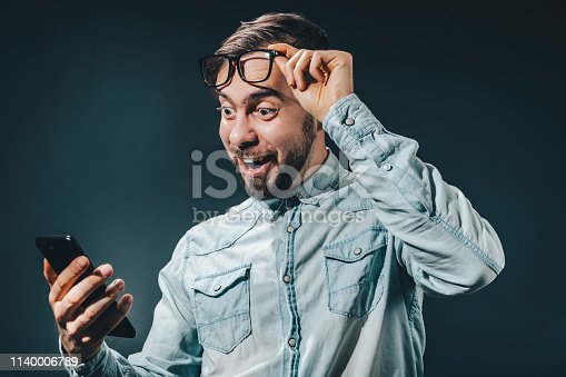 1032204252 istock photo Man celebrating victory after making bets at bookmaker website 1140006789