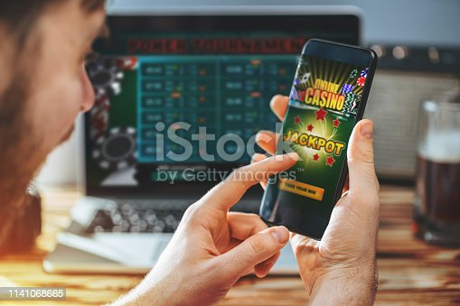 1032204252 istock photo Man celebrating victory after making bets at bookmaker website 1141068665