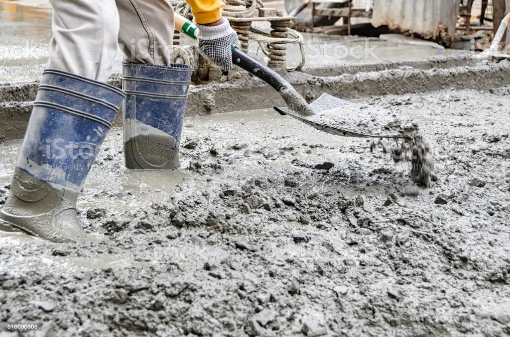 Man Cementing Road stock photo