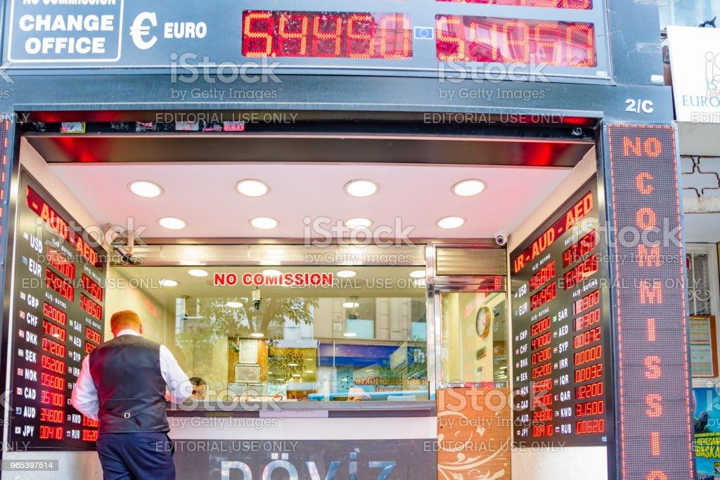 Man changes currency at money changer shop zbiór zdjęć royalty-free