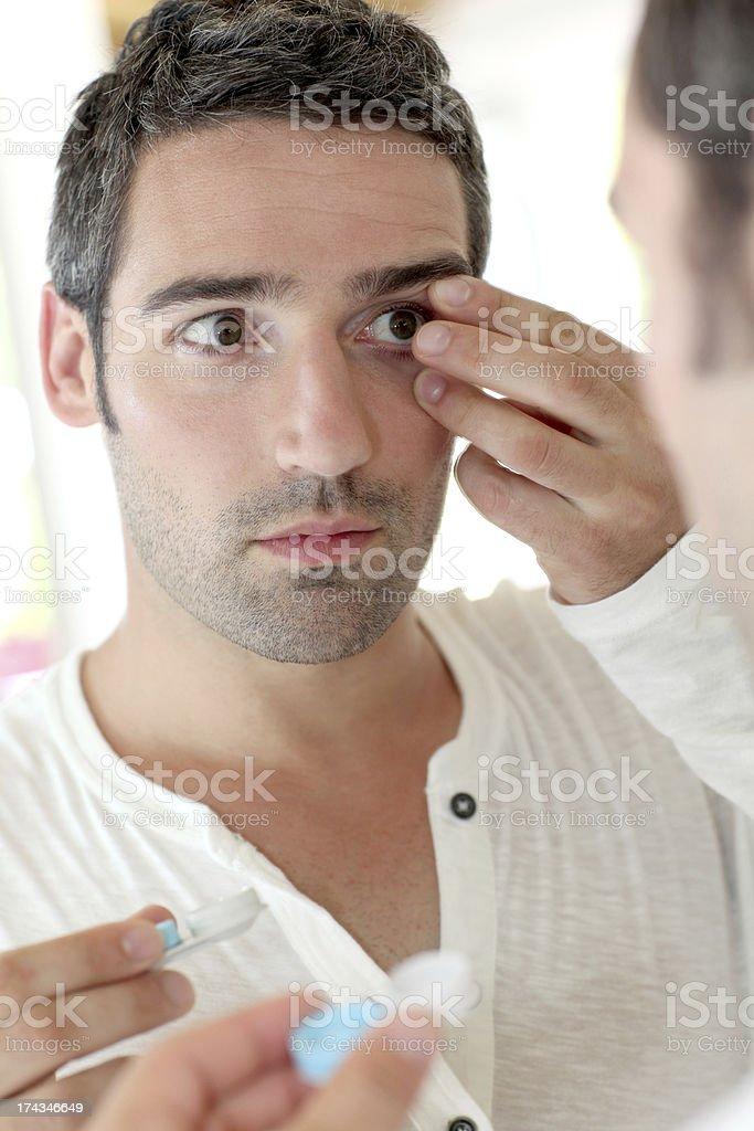 Man changing ocular lens at home royalty-free stock photo
