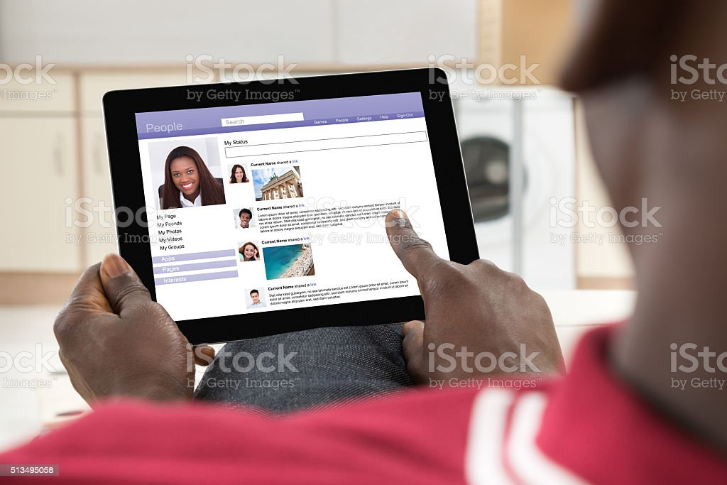 Man Chatting On Social Networking Site stock photo