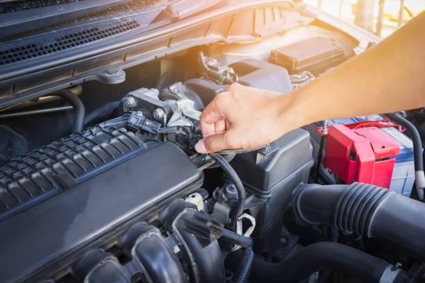 Man check the car engine, vintage effect. - Photo