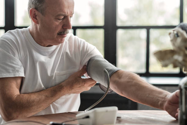 Man checking a blood pressure in the morning stock photo