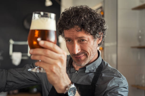 man checking beer quality - brewery stock pictures, royalty-free photos & images