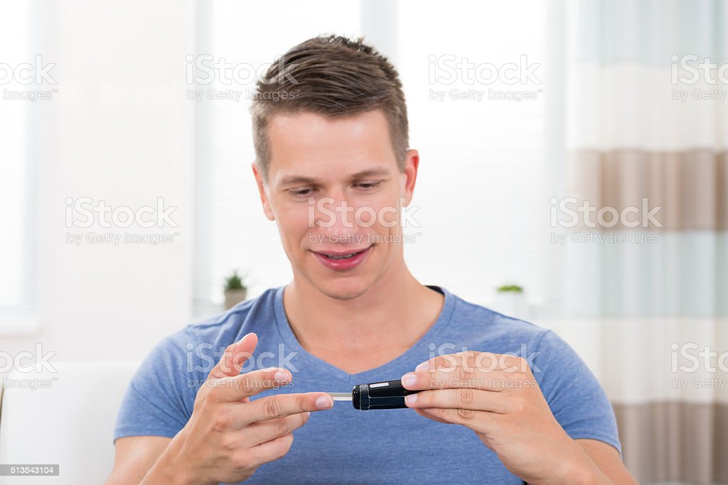 Man Checking Blood Sugar Level stock photo