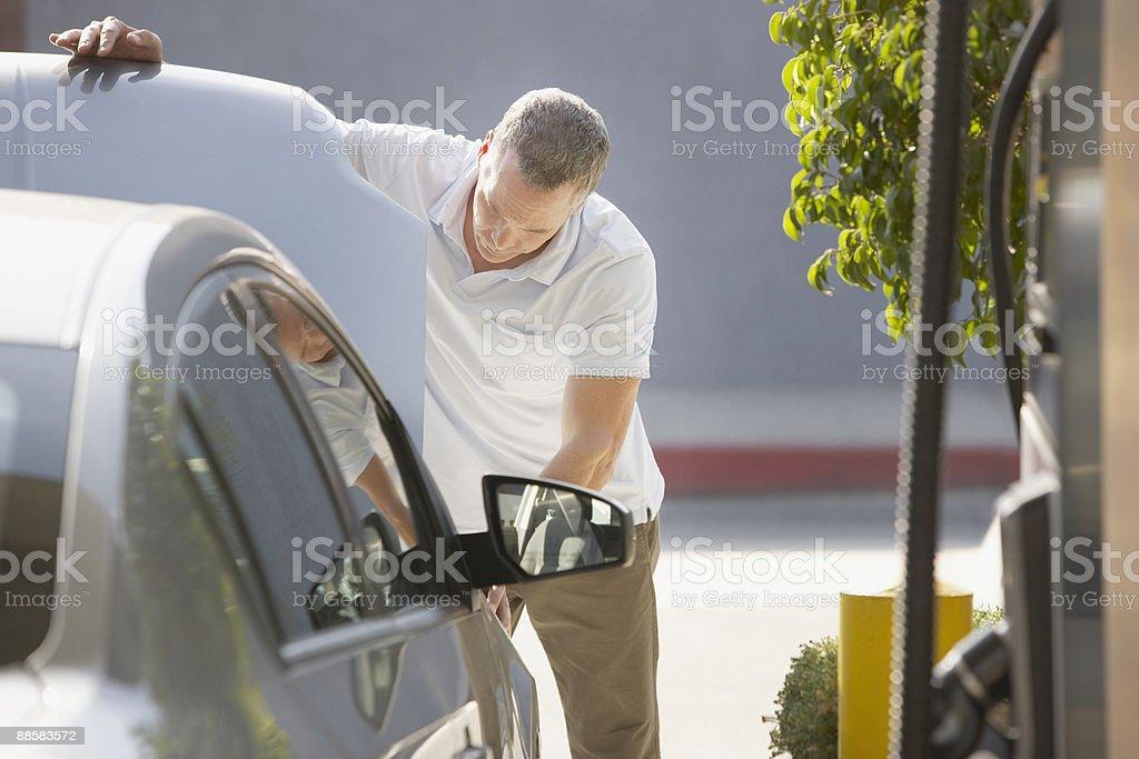 Man checking car engine at service station royalty-free stock photo