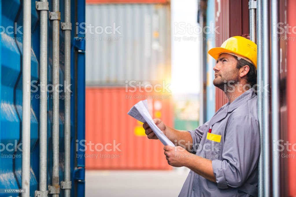 Man Checking Cargo Containers stock photo