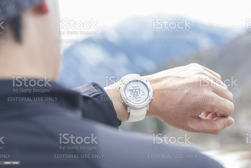 Man checking current altitude on new Suunto wrist watch royalty-free stock photo