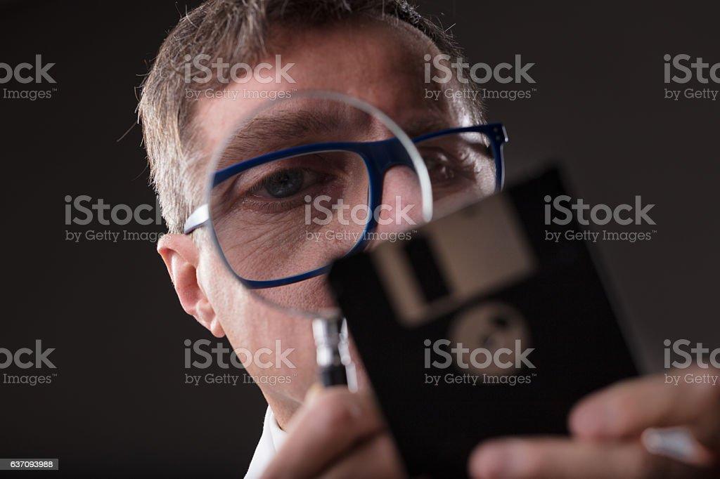 man checking data with a magnifier (data analysis concept) - Foto de stock de Accesibilidad libre de derechos