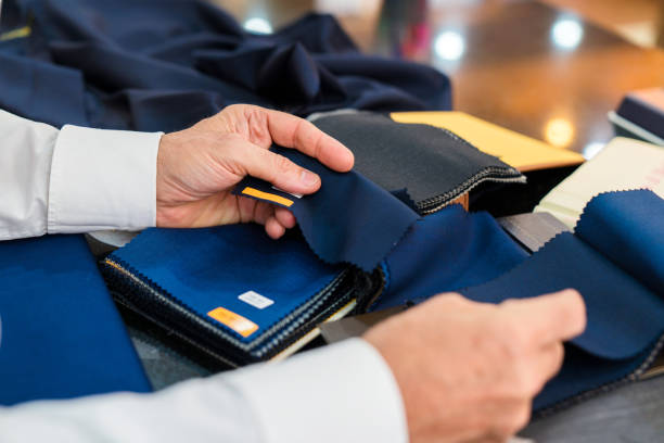 Man checking fabric swatches stock photo