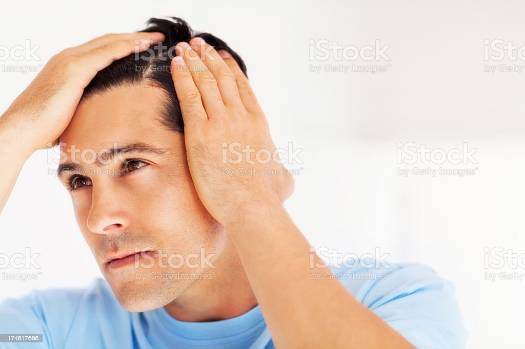 Man Checking Hairline stock photo