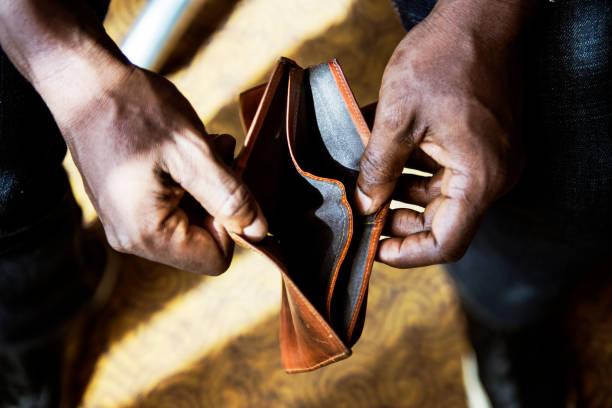 Man checking his empty wallet Man checking his empty wallet empty wallet stock pictures, royalty-free photos & images