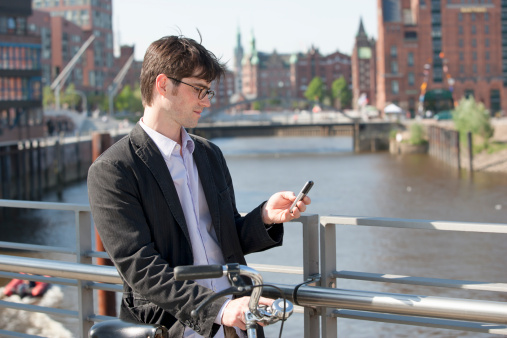Man checking his messages in Hamburg