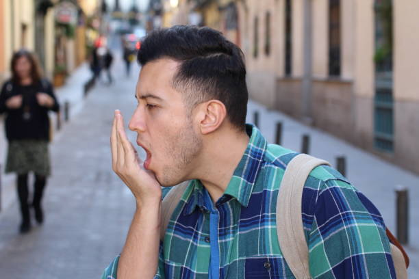 Man checking his own breath stock photo