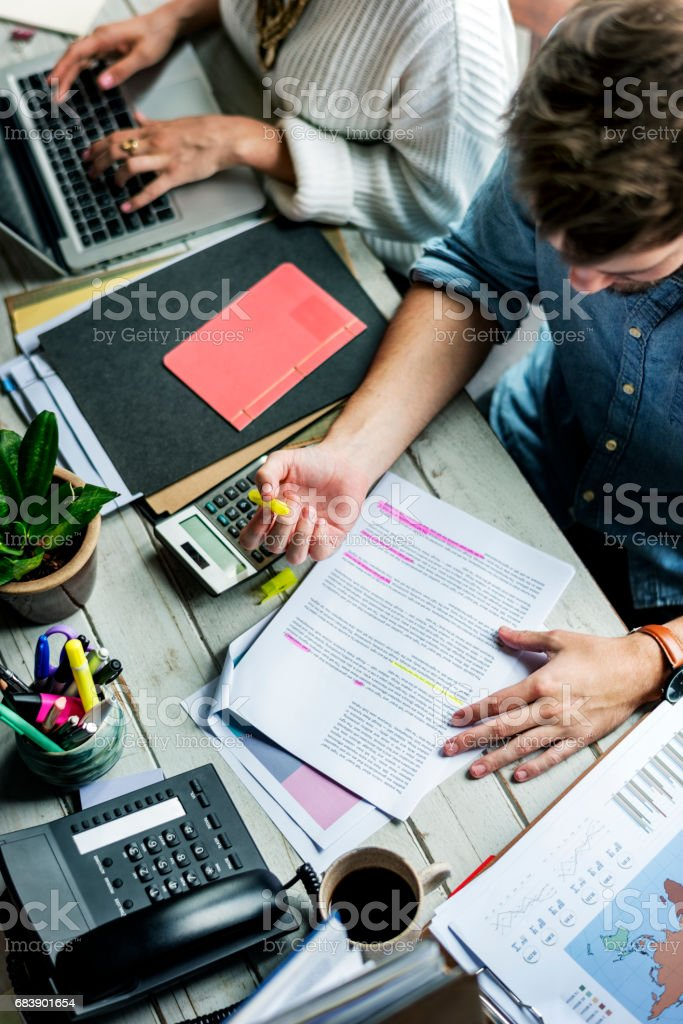 Man Checking Proofing Words on Article Journal stock photo