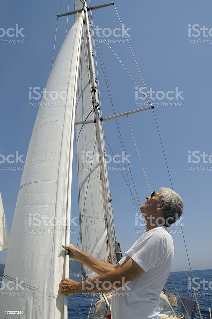 Man checking the sails royalty-free stock photo