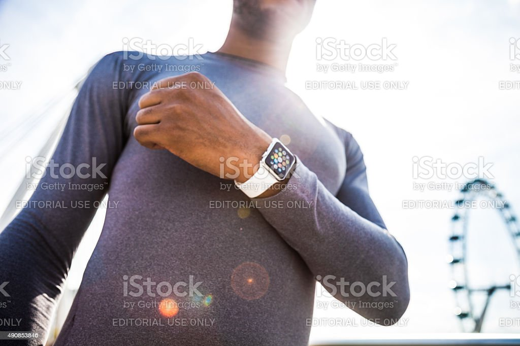 Man checking the time for a run in the city stock photo