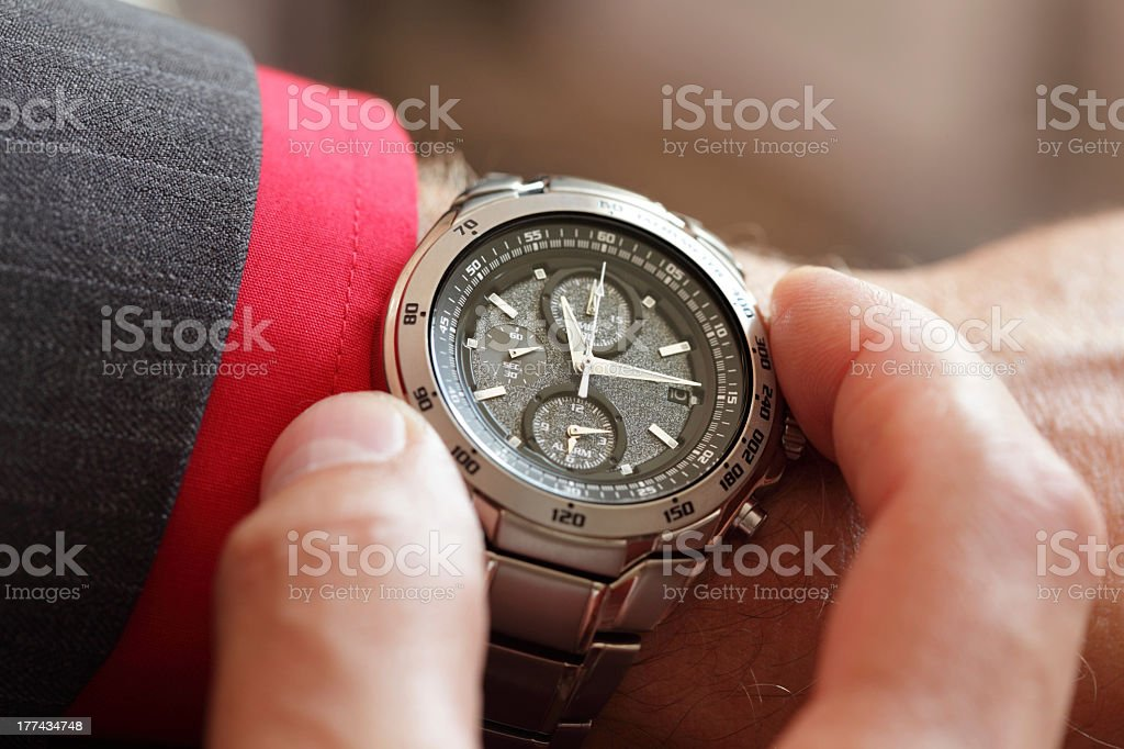 A man checking the time on his watch royalty-free stock photo
