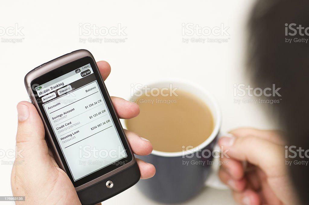 Man checks Banking details on a Smartphone royalty-free stock photo