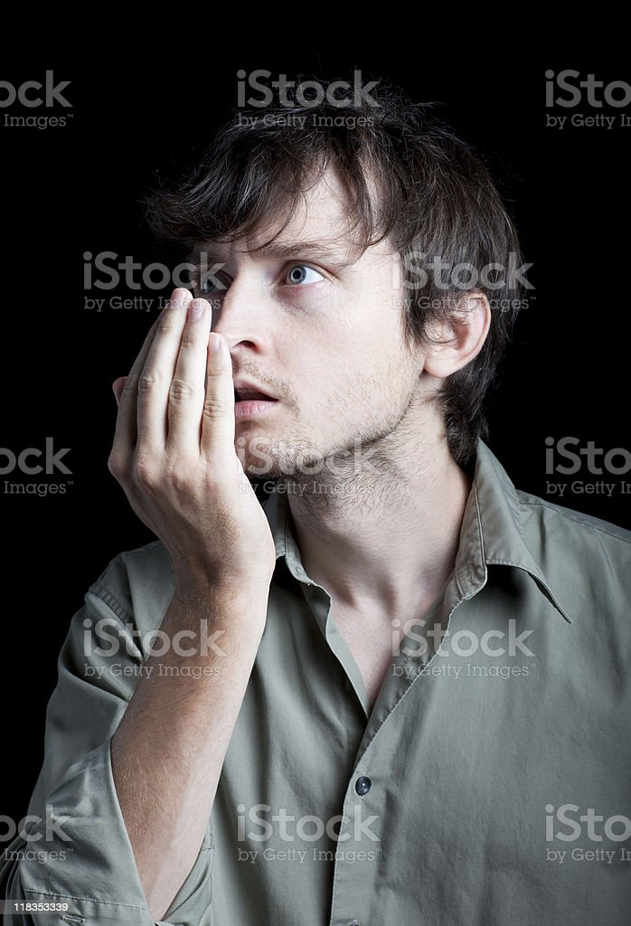 Man checks his breath by breathing into hand (XXL) stock photo