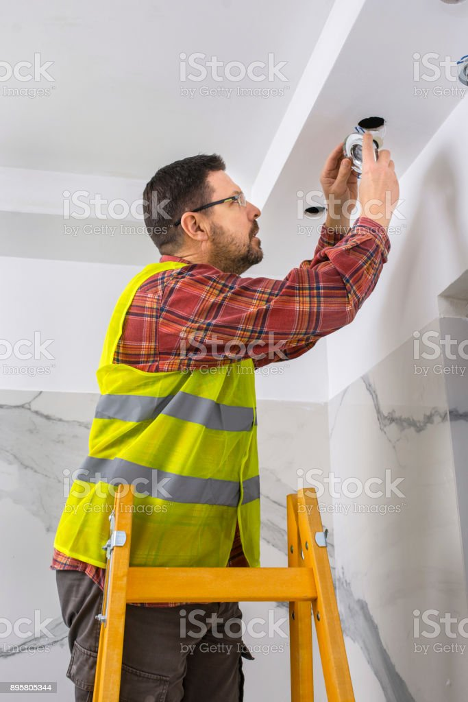 Man checks the bulb stock photo