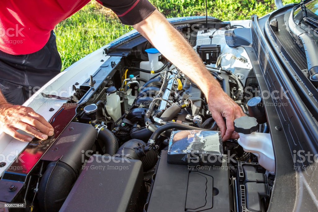 man checks the engine stock photo