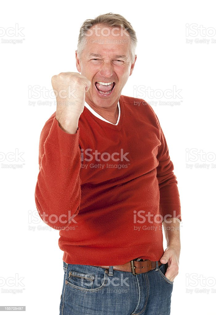 Man cheering with arm up royalty-free stock photo