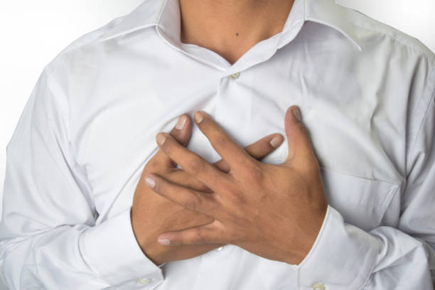 man chest pain from acid reflux or heartburn stock photo