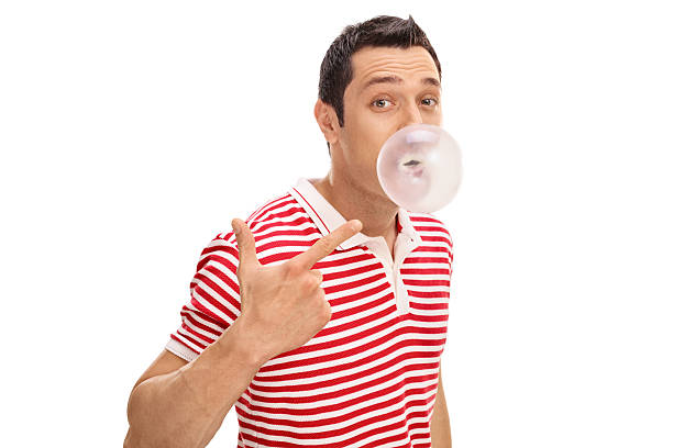 Man chewing a gum and blowing bubble stock photo