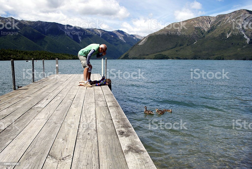 Man & Child on Jetty royalty-free stock photo