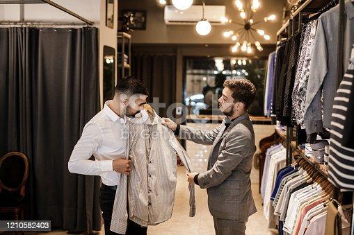 istock Man Choosing A New Shirt 1210582403