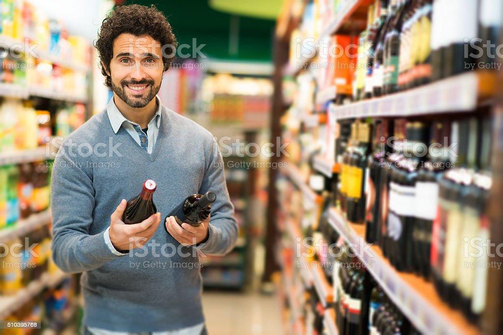 Man choosing a wine bottle stock photo