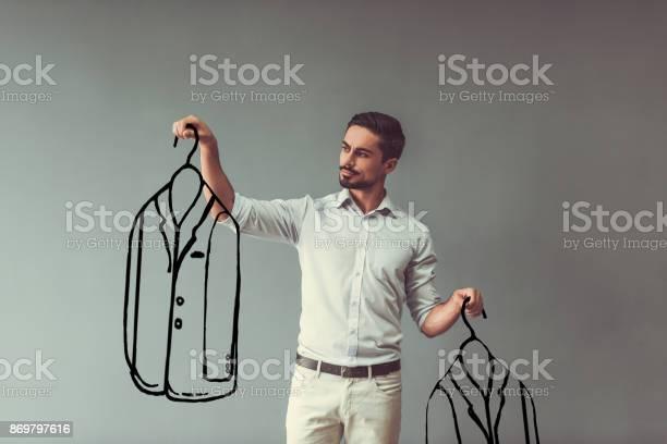 Man choosing clothes picture id869797616?b=1&k=6&m=869797616&s=612x612&h=qdivm32xframmnqbjypjz4qtbgimmdwxpveubwvs4p8=