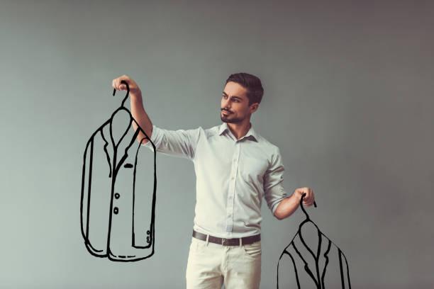 Man choosing clothes stock photo