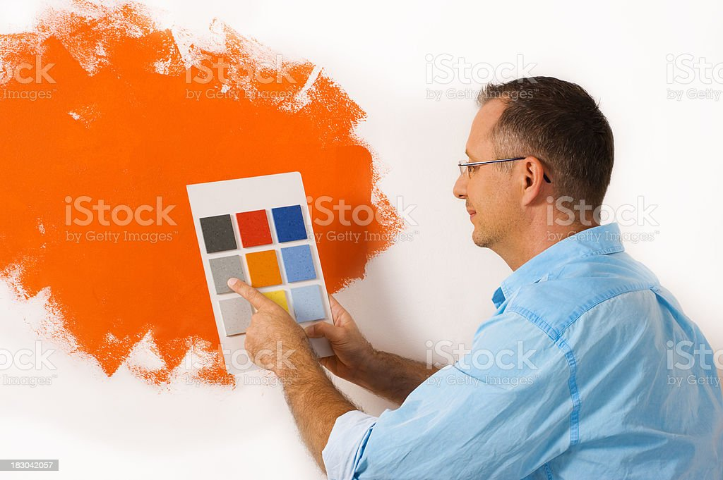 man choosing from a floor swatch royalty-free stock photo