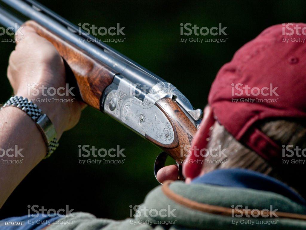 Man clay pigeon shooting stock photo
