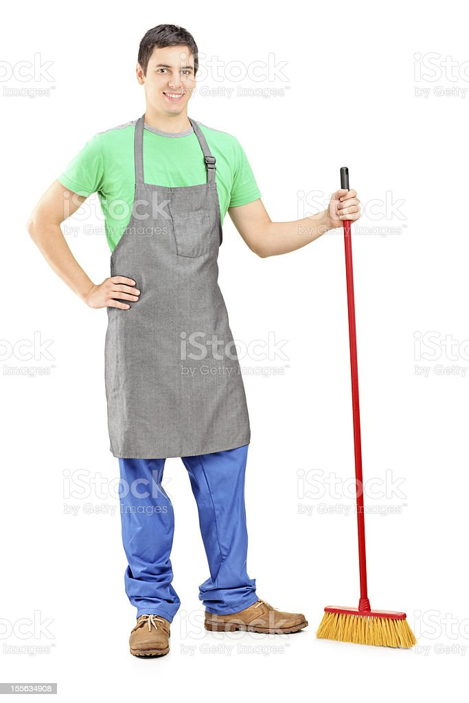 Man cleaner posing with brush in his hand royalty-free stock photo